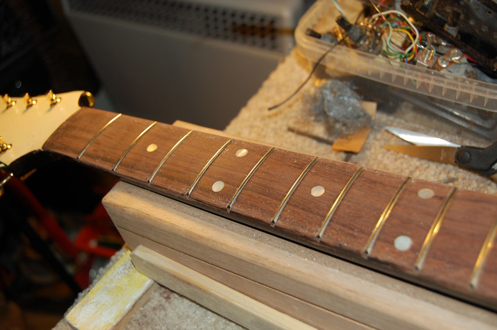 Fret ends smoothed and frets ready for levelling
