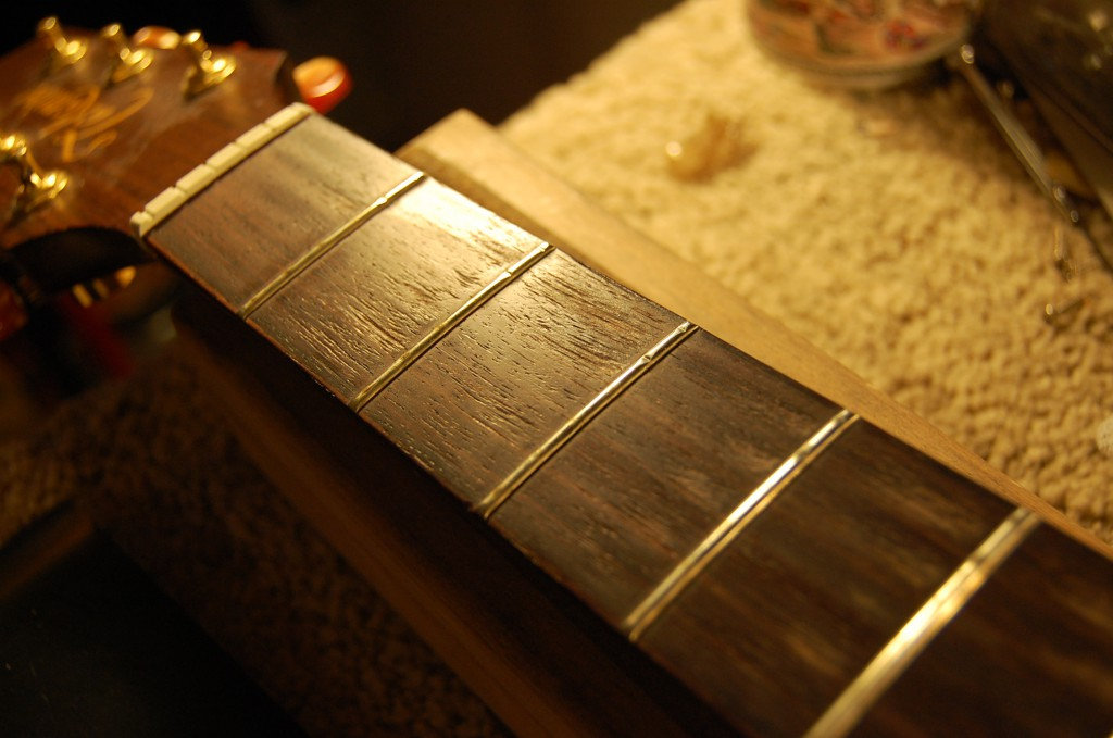 Frets grooved and need levelling
