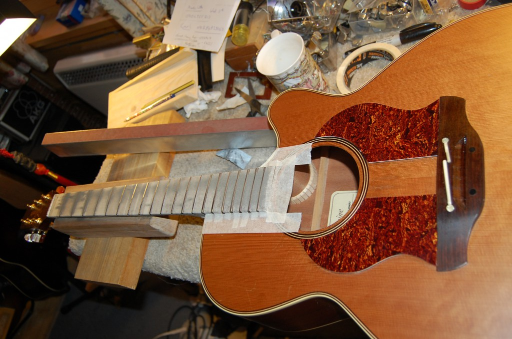 Neck all taped up for fret levelling and recrowning