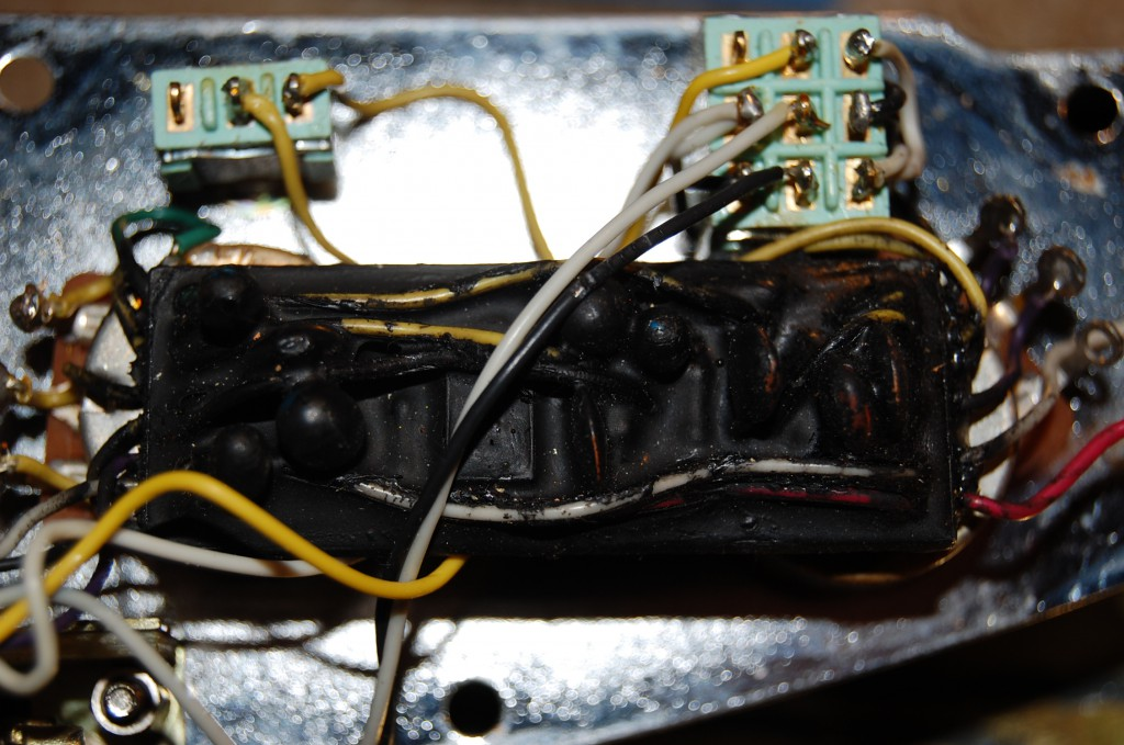 Electronics sprayed with black goop to reduce reverse engineering attempts..