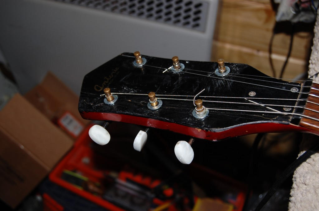 Glue all over the place... poor quality tuners...