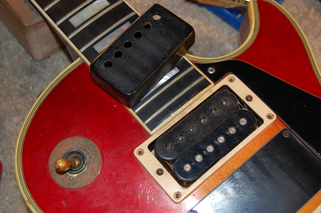 Cover taken off revealed a nice T topped PAF humbucker