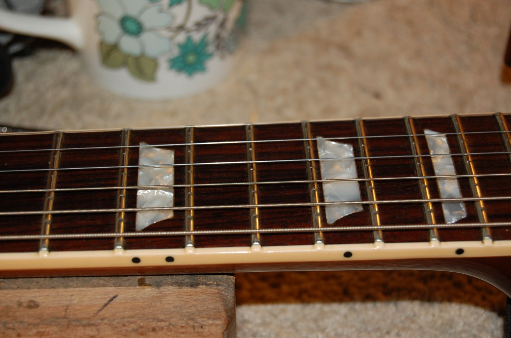 fretboard and frets all cleaned and oiled