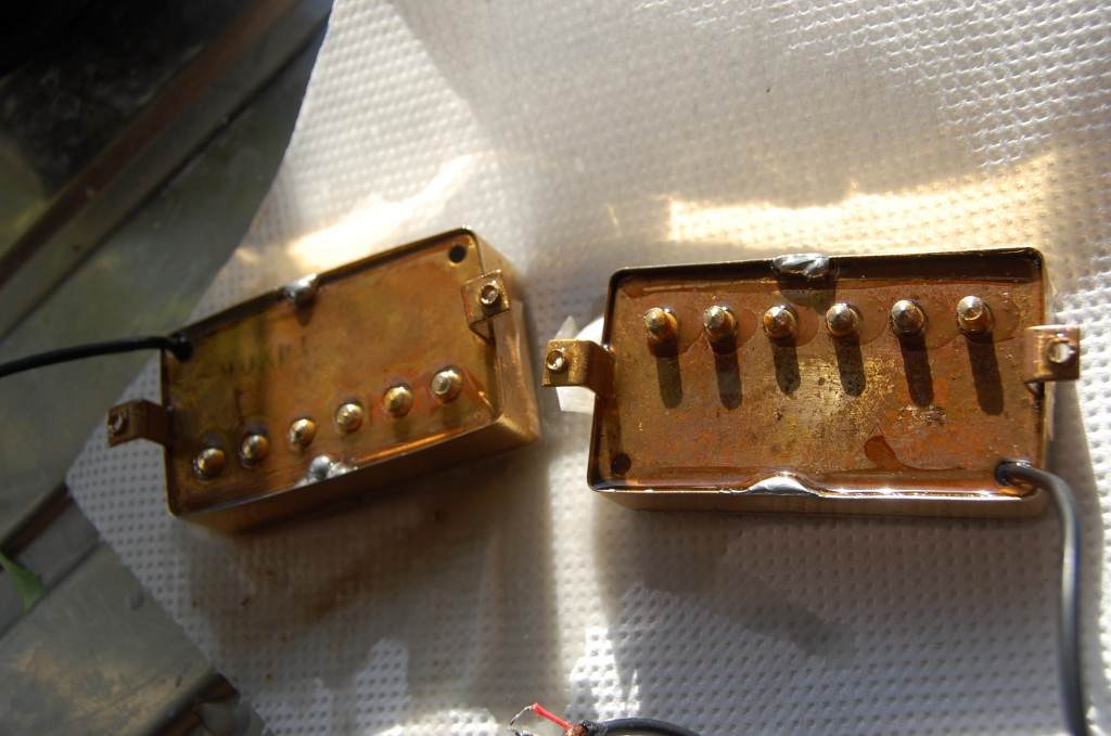 Orignal pickups were single coil and nasty.. I had some 70s Maxon pups that sound great but were microphonic.. so I wasx potted them.. this is the was drying.