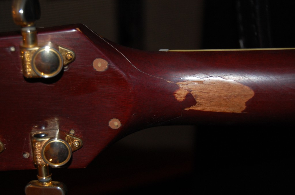 I left the finish damaged but sealed it.. I like guitars to show the scars of their youth.. Screw holes glues and filled I hope the original fix is sound it appears to be